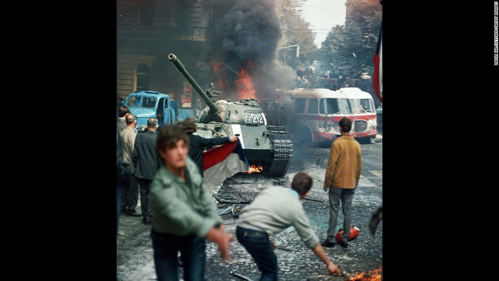 Residents of Prague, Czechoslovakia, throw burning torches in an attempt to stop a Soviet tank on August 21, 1968.  A Soviet-led invasion by Warsaw Pact troops crushed the so-called Prague Spring reform and re-established totalitarian rule.