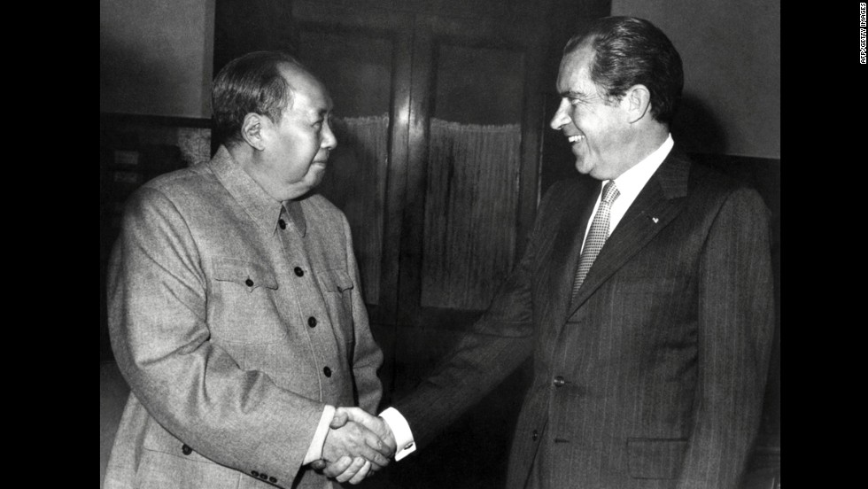 "Chinese leader Mao Zedong shakes hands with U.S. President Richard Nixon after their meeting in Beijing on February 22, 1972. Nixon became the first U.S. president to visit China. The two countries issued a communiqué recognizing their ""essential differences"" while making it clear that ""normalization of relations"" was in all nations' best interests. The rapprochement changed the balance of power with the Soviets. Two-and-a-half years later, Nixon resigned as president amid the Watergate scandal."
