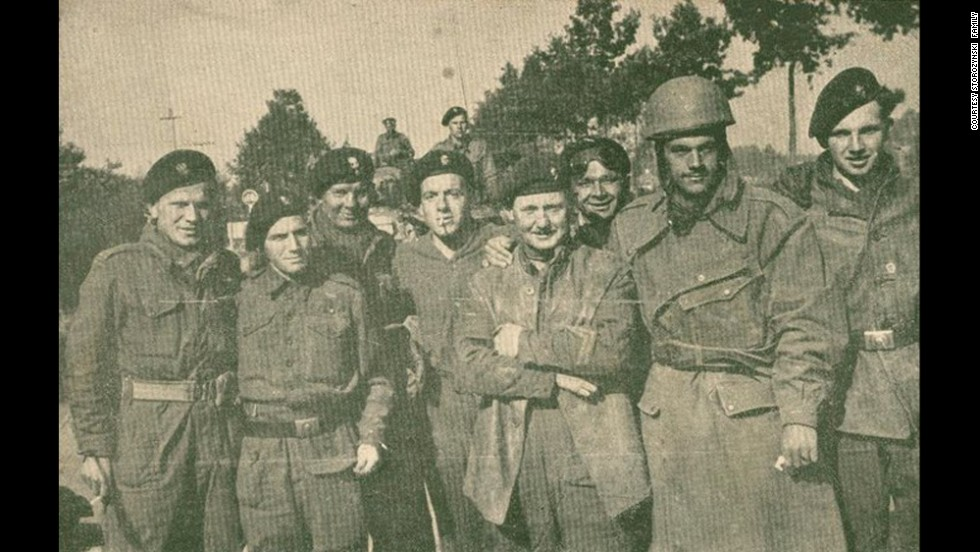 Dionizy Storozynski, wearing a helmet, poses with members of his regiment -- the Polish 24 Lancers -- during the invasion of Normandy, near Abbeville, France. <br />He was a motorcycle scout.