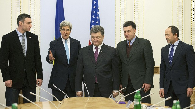 "(L to R) Head of the Ukrainian UDAR (PUNCH) party and candidate in Ukraine's early presidential election Vitali Klitschko, US Secretary of State John Kerry, Ukrainian member of parliament and businessman Petro Poroshenko, head of the Ukrainian nationalist Svoboda party Oleh Tyahnybok, and Ukrainian member of parliament for the Regions Party Sergiy Tigipko stand during their meeting in Kiev on March 4, 2014. Kerry became the highest-profile foreign diplomat to visit Ukraine's interim government, offering a $1 billion support package in the face of an escalating crisis with Russia. Kerry accused Russia on March 4 of looking for a ""pretext"" to invade Ukraine after taking de-facto control of the ex-Soviet state's strategic Crimea peninsula. AFP PHOTO / POOL / KEVIN LAMARQUEKEVIN LAMARQUE/AFP/Getty Images"
