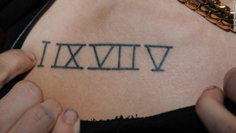 Bieber sports the Roman numerals  I, IX, VII and V on his chest which stands for the numbers 1, 9, 7 and 5.