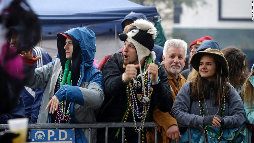 Paradegoers watch the Krewe of Zulu march in New Orleans.