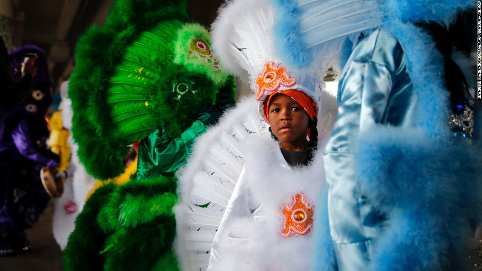 Kyren Stalls, 7, lines up with the children of the Red Flame Hunters Mardi Gras Indian Tribe under the interstate along Claiborne Avenue in New Orleans.