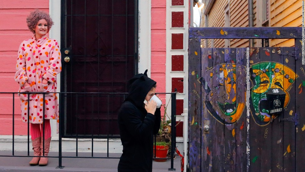 """People in the Treme neighborhood of New Orleans start Mardi Gras celebrations early Tuesday morning. <a href=""""http://www.cnn.com/2014/02/16/travel/gallery/carnival-around-the-world/index.html"""">View more photos of carnival festivities around the world.</a>"""