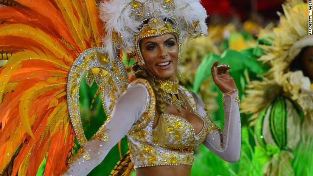 A dancer of the Vila Isabel samba school performs during the second night of carnival parade at the Sambadrome in Rio de Janeiro, on March 4, 2014.