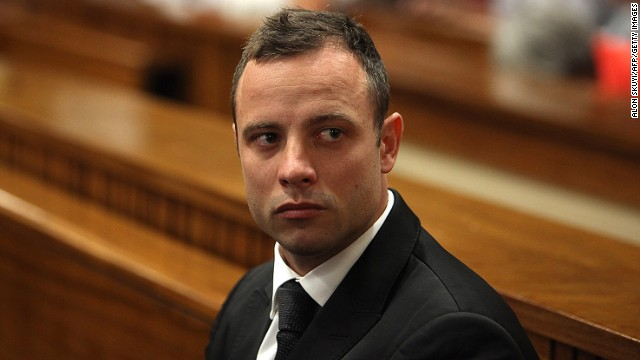 South African Paralympic athlete Oscar Pistorius, accused of murdering his girlfriend Reeva Steenkamp waits prior to a hearing of his trial at the North Gauteng High Court in Pretoria, on March 5, 2014.