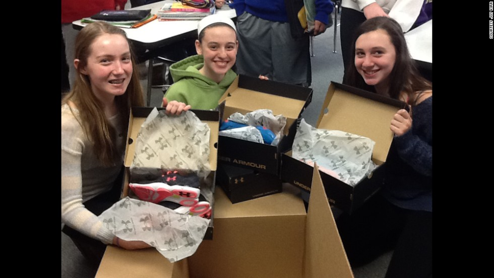 Seventh-graders Emily Born, Lauryn Lintner, Grace Maher, left to right, decided to compare running shoes for their genius hour project, which began in September at Thomas Middle School in Arlington Heights, Illinois. They contacted sports clothing and accessories companies to request samples for testing, and Under Armour sent some in late February.
