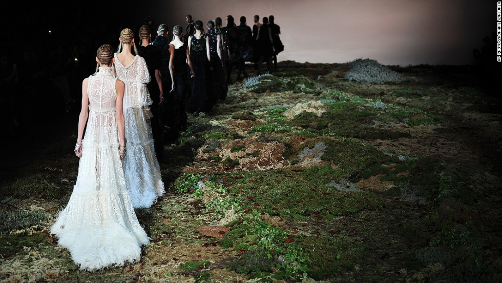 "MARCH 5 - PARIS, FRANCE: Models wear creations for the Alexander McQueen ready-to-wear fall/winter 2014-2015 fashion collection on March 4. <a href=""http://www.cnn.com/2014/03/04/world/europe/blood-sweat-and-silk-on-the-long-road-to-paris-fashion-week/"">Tradition, quality materials, creativity and global exposure</a> make Paris the ultimate and most desired platform for young and established designers alike."
