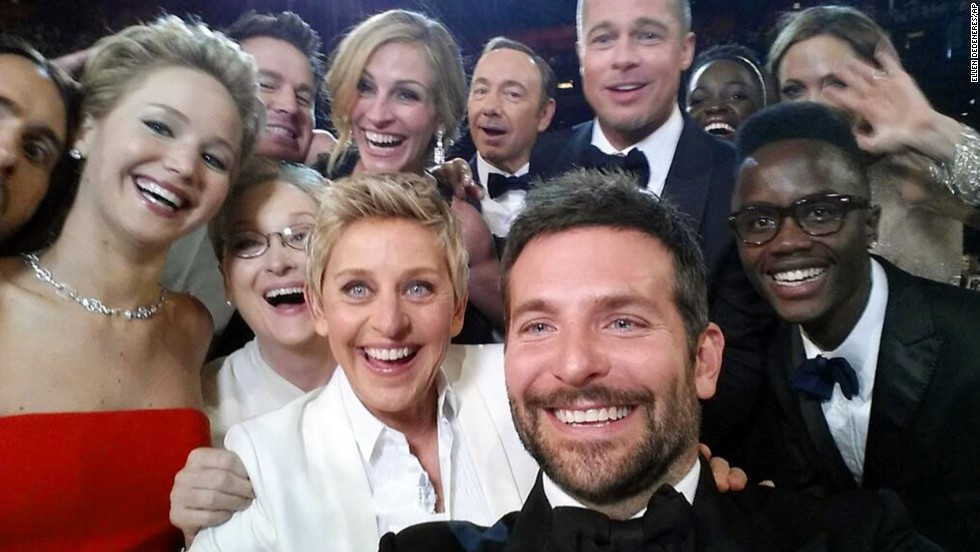 "Host Ellen DeGeneres takes a moment to orchestrate a selfie with a group of movie stars at the <a href=""http://www.cnn.com/2014/03/02/showbiz/gallery/2014-oscars-highlights/"">Academy Awards ceremony</a> on Sunday, March 2. Actor Bradley Cooper, seen in the foreground, was holding the phone at the time. ""If only Bradley's arm was longer,"" <a href=""https://twitter.com/TheEllenShow/status/440322224407314432"" target=""_blank"">DeGeneres tweeted</a>. ""Best photo ever."" It became the most retweeted post of all time."