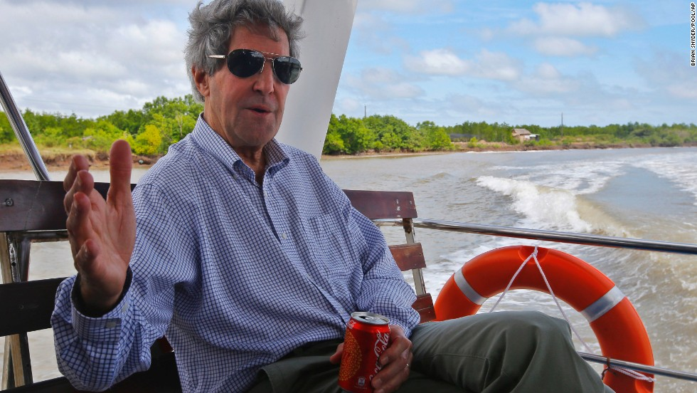 Kerry talks to reporters on a boat on the Mekong River Delta in Vietnam in December. Kerry had patrolled the muddy waters 40 years earlier as a U.S. naval officer. Kerry also visited Ho Chi Minh City and Hanoi.
