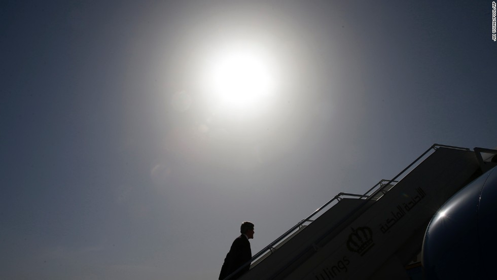 Kerry boards a plane in Amman, Jordan, where in May 2013 he met with leaders to discuss the ongoing conflict in Syria.