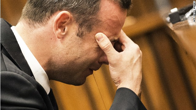 Oscar Pistorius cries while a witness gives graphic testimony of the night his girlfriend Reeva Steenkamp was killed .