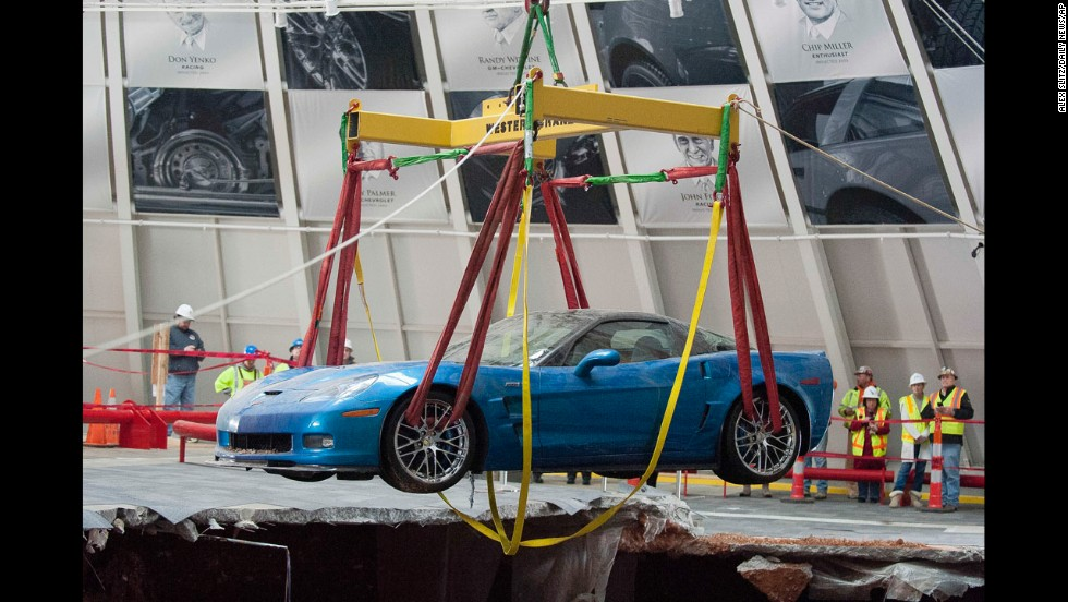 "One of the eight Chevrolet Corvettes <a href=""http://www.cnn.com/2014/02/13/us/national-corvette-museum-cars-fall/index.html"">swallowed by a large sinkhole</a> is removed by a crane Monday, March 3, at the National Corvette Museum in Bowling Green, Kentucky."