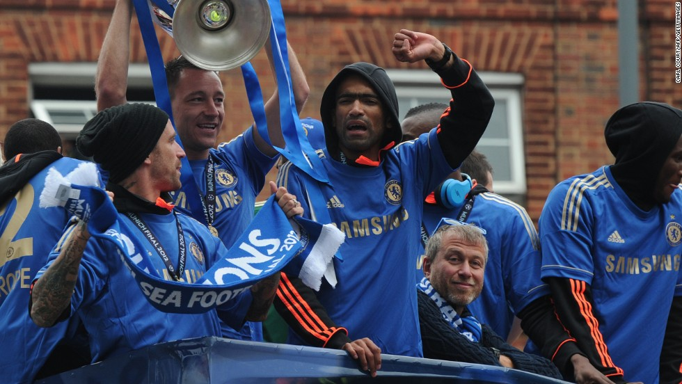 Chelsea Football Club's owner, Russian billionaire Roman Abramovich, celebrates the 2012 Champions League trophy with players John Terry, Raul Meireles and Jose Bosingwa. He bought the club in 2003 for reported $234 million.