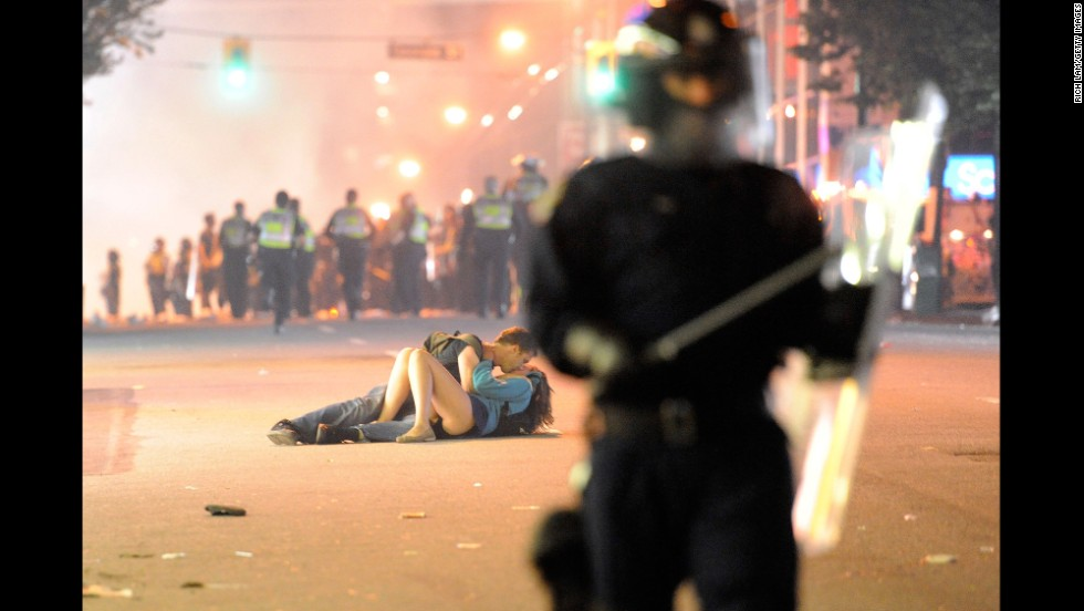 "A couple kisses during a riot in Vancouver, British Columbia, after the hometown NHL hockey team lost the Stanley Cup Final in June 2011. Getty Images, an online photo archive with more than 35 million images, is now allowing ""noncommercial"" users to use this and other photos for free on their websites or social media. Click through to see some of the other iconic images now available."