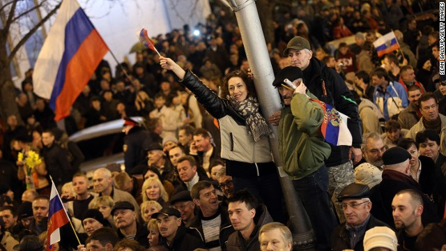People waving Russian flags cheer following the confirmation by the Sevastopol regional council to support the vote for Crimea to secede from Ukraine and join Russia passed by the Crimean Parliament earlier in the day on March 6, 2014 in Sevastopol, Ukraine.