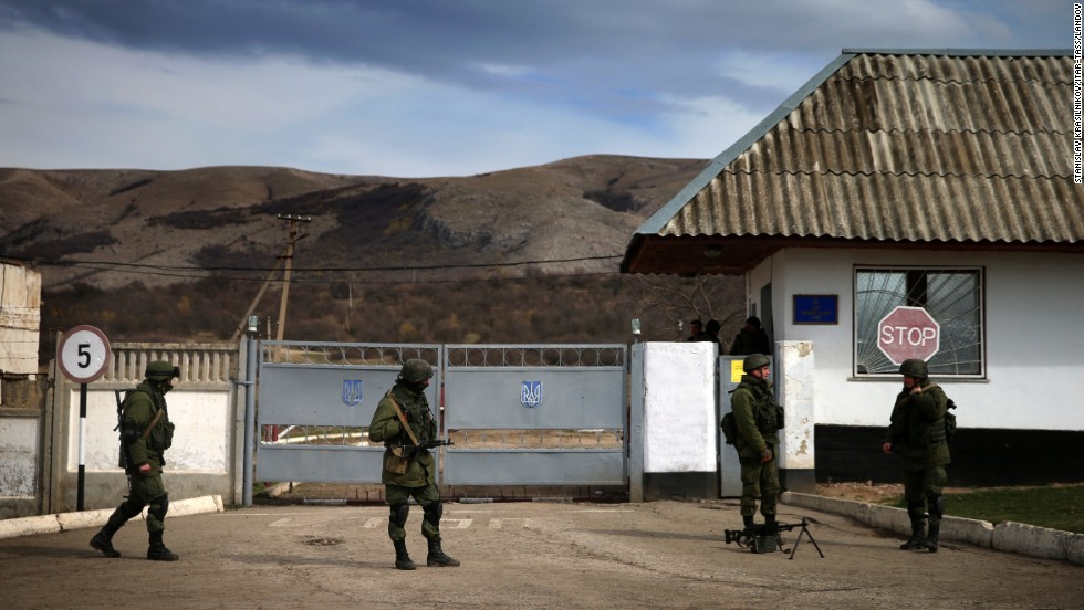 Servicemen guard a checkpoint at a Ukrainian navy base in Perevalne on March 6.