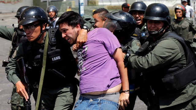 Bolivarian National Guards arrest an anti-government protester during clashes in the Los Ruices neighborhood of Caracas, Venezuela, on Thursday, March 6.