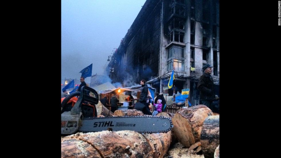 "KIEV, UKRAINE:  ""Cutting wood to keep volunteers warm as they continue to guard Independence Square in Kiev."" - CNN's Khalil Abdallah on March 5.  Follow Khalil on Instagram at <a href=""http://instagram.com/madcameraman"" target=""_blank"">instagram.com/madcameraman</a>."