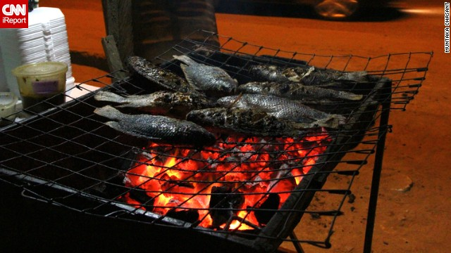 Tilapia grilled over the charcoal fire is a common late night street food in the southern parts of Ghana. Brushed with a spicy pepper paste, it can be eaten alone or with 'banku', a pase made from fermented corn or cassava dough.