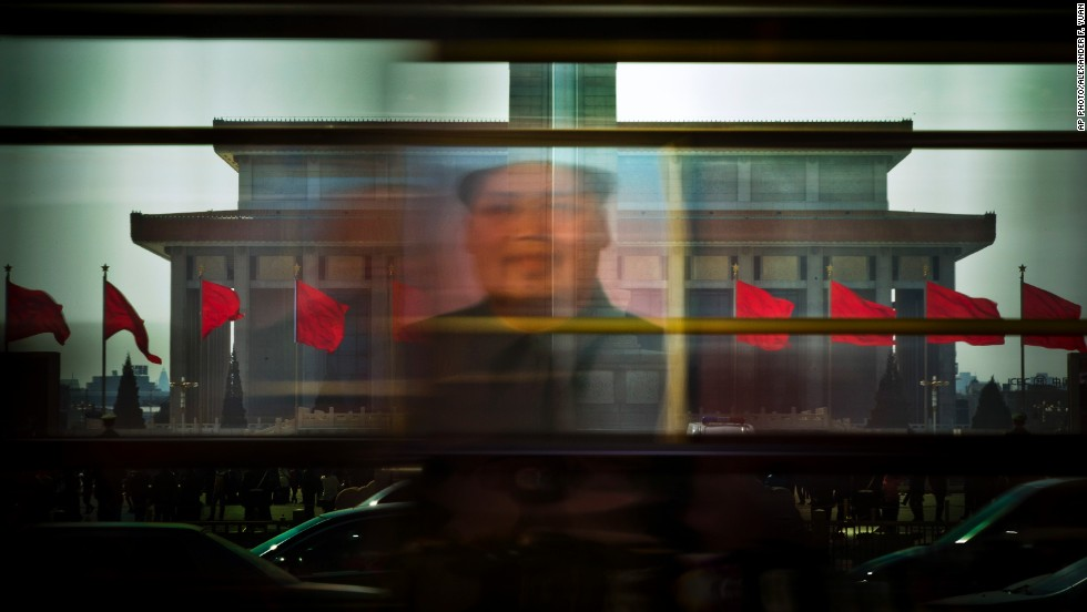 MARCH 7 - BEIJING, CHINA: Portrait of the late Communist leader Mao Zedong is reflected on a bus passing through Tiananmen Square -- the venue for the annual National People's Congress of China. The agenda is focused mainly on the key economic reforms outlined last year.