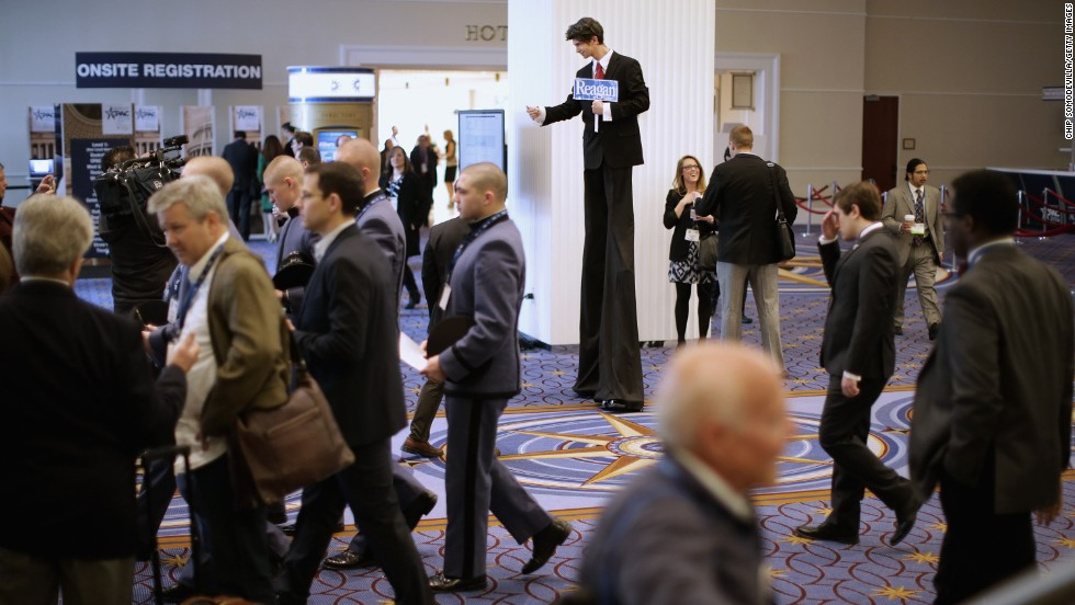 Stilt walker Joshua Longshore of Brooklyn dresses as former President Ronald Reagan.