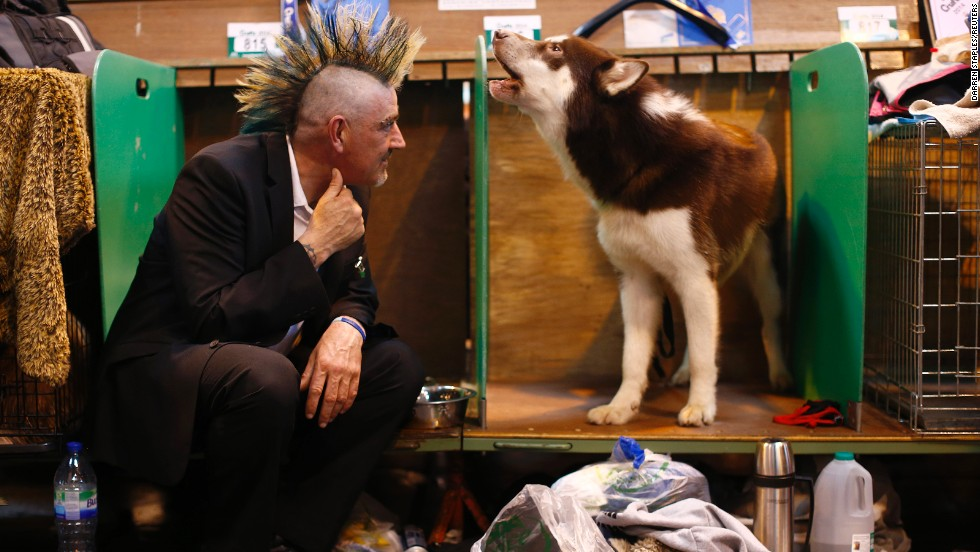 Pete Dowling listens as Zoran, a Canadian Eskimo dog, howls on March 6.