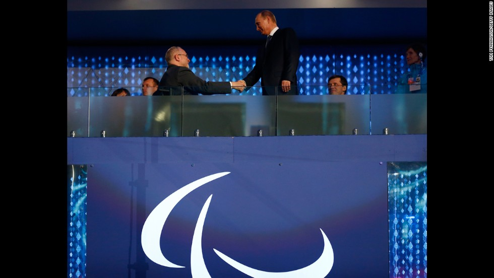 Sir Philip Craven, the president of the International Paralympic Committee, shakes hands with Russian President Vladimir Putin, right.