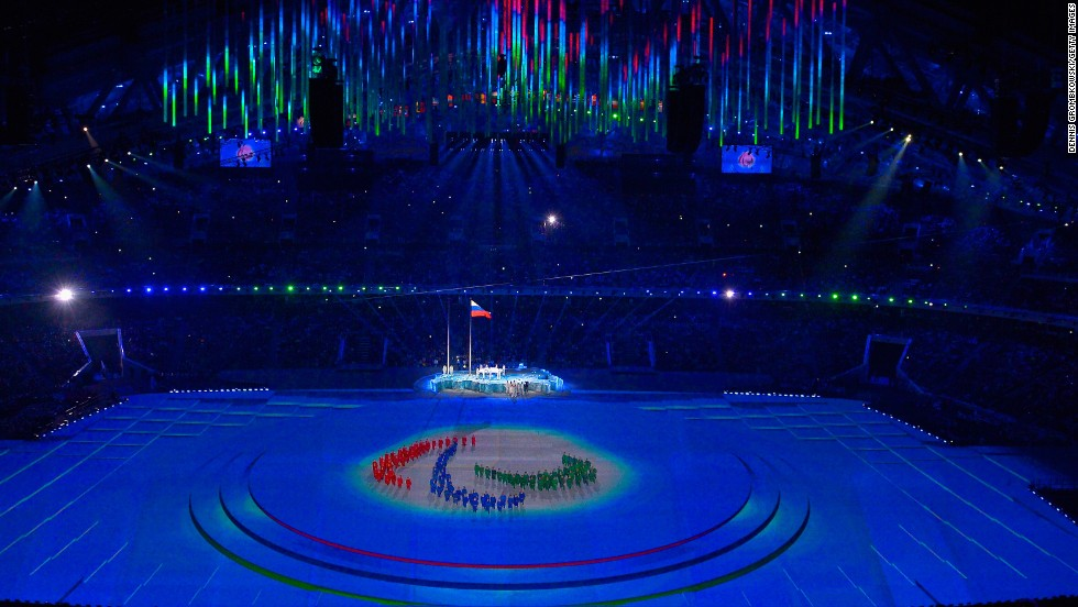 The Paralympic flag is raised during the ceremony.