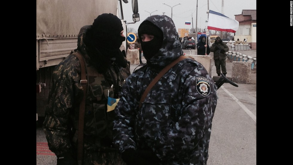 "SOUTHERN UKRAINE:  Gunmen block monitors from the Organization for Security and Co-operation in Europe (OSCE) who are trying unsuccessfully to negotiate their way into Crimea past pro-Russian border patrols on March 7.  Photo by CNN's Christian Streib.  Follow Christian on Instagram at <a href=""http://instagram.com/christianstreibcnn"" target=""_blank"">instagram.com/christianstreibcnn</a>"