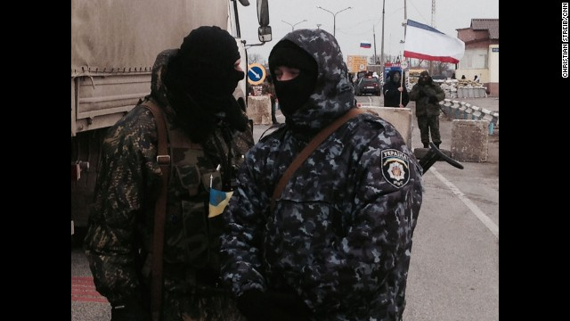 CHONHAR, UKRAINE:  Pro-Russian gunmen block OCSE monitors trying to negotiate their way into Crimea past pro-Russian border patrols with no luck.  Photo by CNN's Christian Streib.   WATCH ON CNN.COM   as CNN's Mathew Chance reports from southern Ukraine.    Follow Christian (@christianstreibcnn) and other CNNers along on Instagram at instagram.com/cnn.