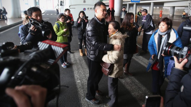 A relative of a passenger onboard Malaysia Airlines flight MH370 (Center Right) cries at Beijing International Airport March 8, 2014 in Beijing, China. Malaysia Airlines Flight MH370 from Kuala Lumpur to Beijing and carrying 239 onboard was reported missing after the crew failed to check in as scheduled while flying over the sea between Malaysia and Ho Chi Minh City in Vietnam, according to published reports