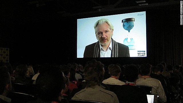 Exiled WikiLeaks founder Julian Assange speaks to a festival audience in Austin, Texas, via livestream from London.