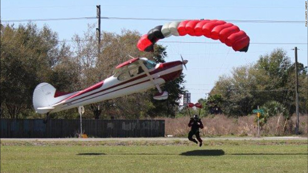 The plane took a nosedive and the skydiver was thrown to the ground.
