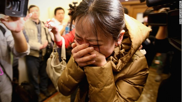 A relative of one of the Chinese passengers on board Flight 370 weeps at a Beijing hotel where families awaited information.