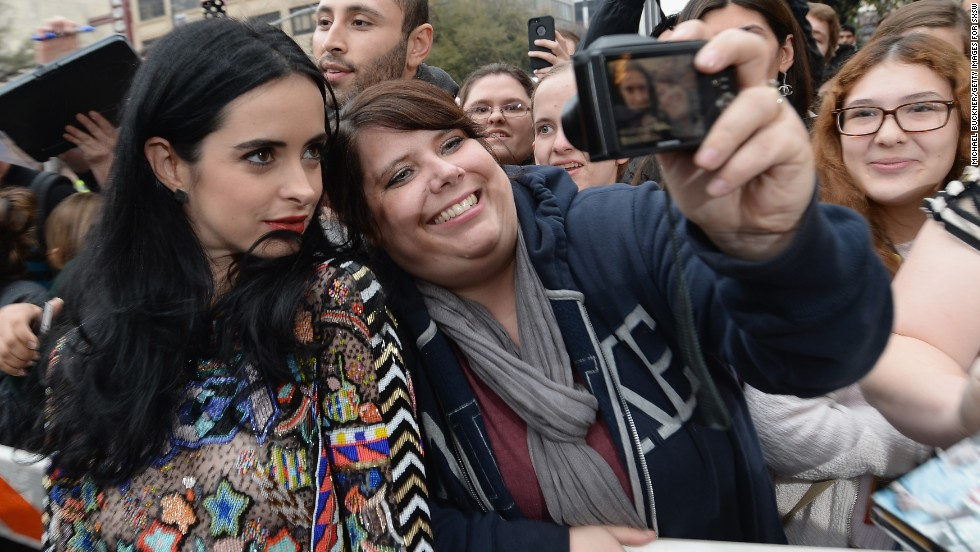 "Actress Krysten Ritter (""Breaking Bad"") poses with a fan before the ""Veronica Mars"" premiere on March 8."