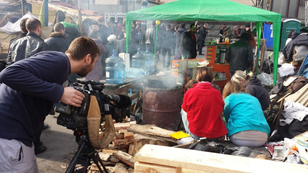 "KIEV, UKRAINE:  CNN cameraman Scott McWhinnie films volunteers peeling vegetables, preparing meals for protesters still living in tents in Maidan, also known as Independence Square, on March 9.  Photo by CNN's Michael Holmes.  Follow Michael on Instagram at <a href=""http://instagram.com/holmescnn"" target=""_blank"">instagram.com/holmescnn</a>."