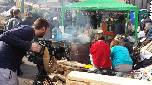 KIEV, UKRAINE:  CNN cameraman Scott McWhinnie films volunteers peeling vegetables, preparing meals for protesters still living in tents in Maidan, also known as Independence Square in Keiv, Ukraine on March 9.  Russian President Vladimir Putin defended the breakaway moves by the pro-Russian leaders of Crimea in conversations with two world leaders on Sunday, while the autonomous Ukrainian region was the scene of emotional demonstrations by both sides.  Photo by CNN's Michael Holmes.  Follow Michael (@holmescnn) and other CNNers along on Instagram at instagram.com/cnn.