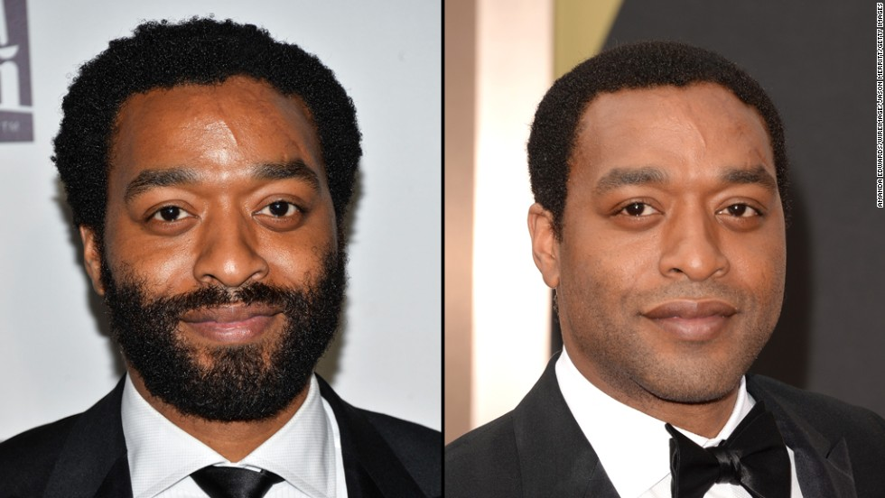 Chiwetel Ejiofor wears a full beard at the 2014 Golden Globes in January, but trims it off for the Oscars.
