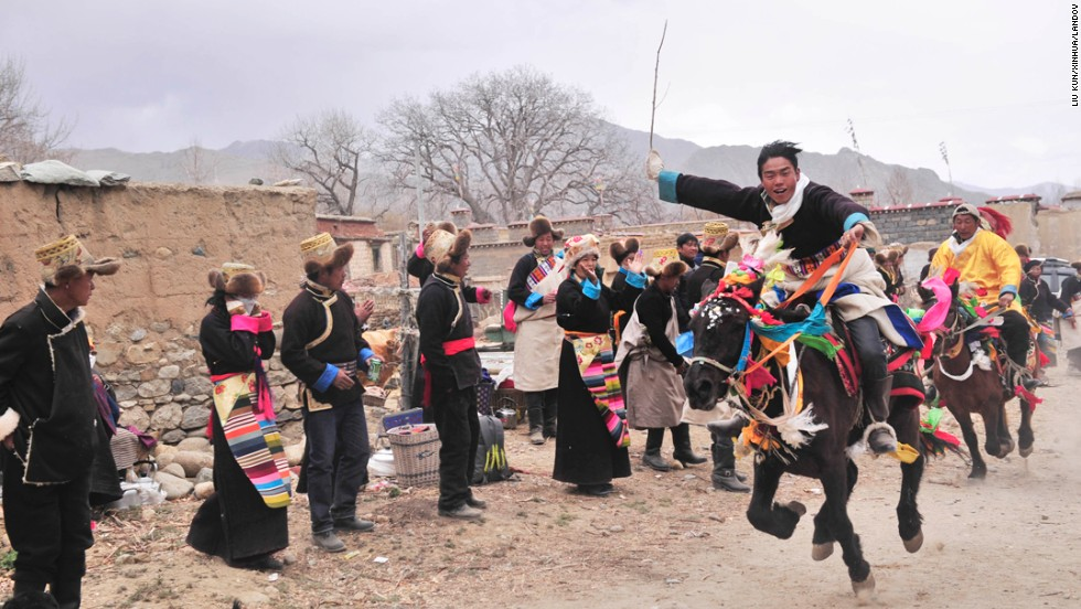 Villagers in Lhasa, Tibet, take part in a horse racing event Wednesday, March 5, during a ceremony marking the start of spring plowing. In the Daga Village, it is tradition to hold the ceremony on the fourth day of Losar, the Tibetan New Year.