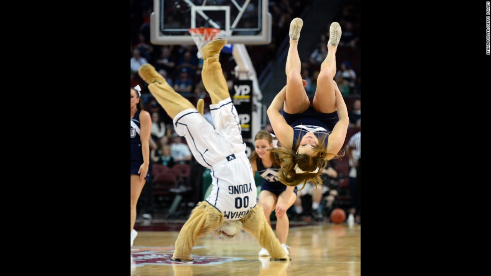 A cheerleader from Brigham Young University flips along with the school's mascot, Cosmo, at the West Coast Conference basketball tournament Saturday, March 8, in Las Vegas.