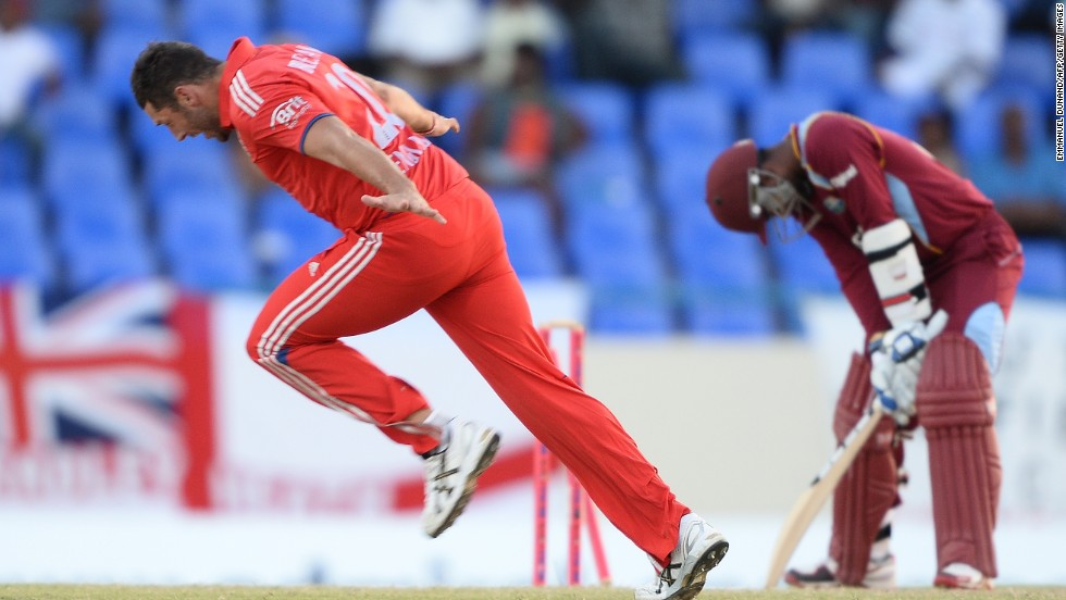 Bowler Tim Bresnan, left, takes the wicket of West Indies batsman Denesh Ramdin to give England victory Wednesday, March 5, in a One Day International match between the two teams.