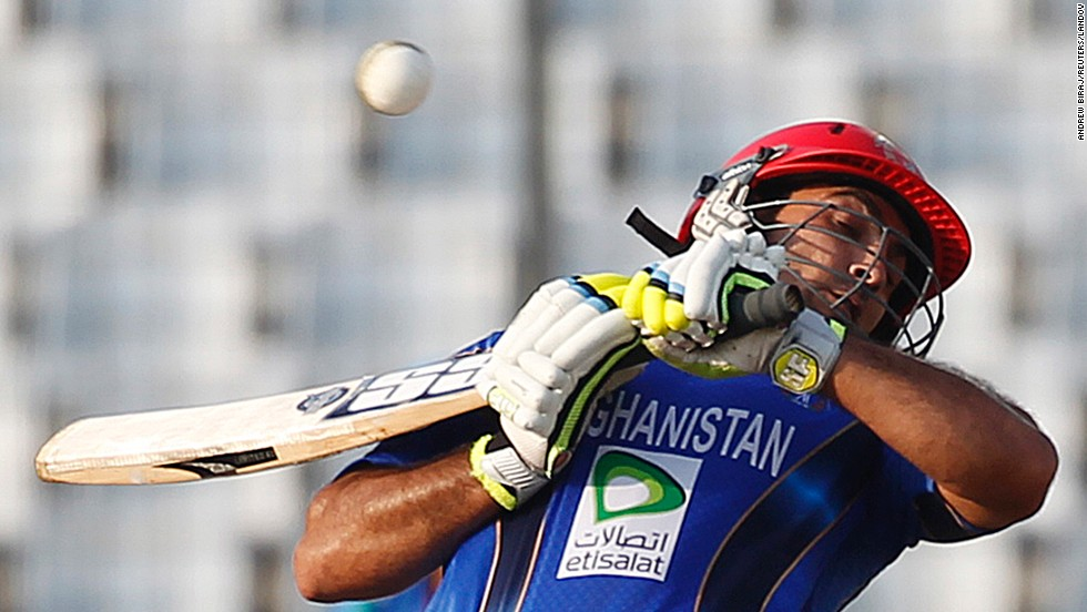 Afghanistan's Samiullah Shenwari avoids a bouncer against India during their one-day international cricket match Wednesday, March 5, at the Asia Cup in Dhaka, Bangladesh.