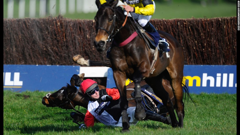 Adrian Doyle falls off Merrion Square during a steeplechase race Saturday, March 8, at Sandown Park in Esher, England.