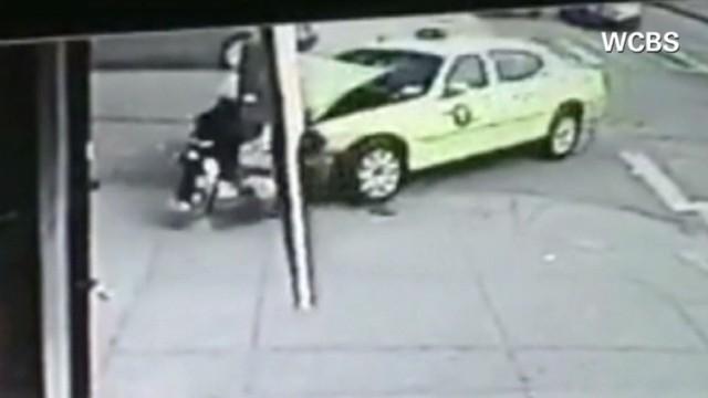 See taxi smash into school bus