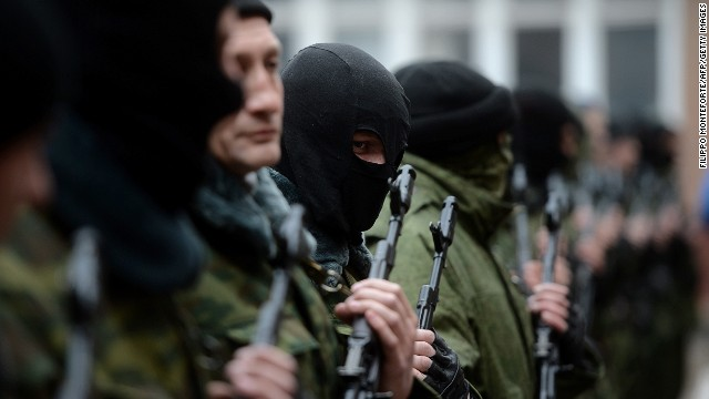 Pro-Russian forces dubbed the 'military forces of the autonomous republic of Crimea' stand before their swearing-in ceremony in the Republican military enlistment complex in Simferopol on March 10, 2014.