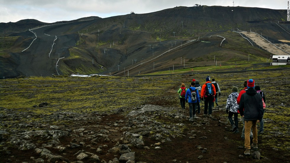 Hikers head to the ash-covered fields at Blafjoll, where Thrihnukagigur's magma chamber lies. The mountain range is only 20 kilometers southeast from Reykjavik.