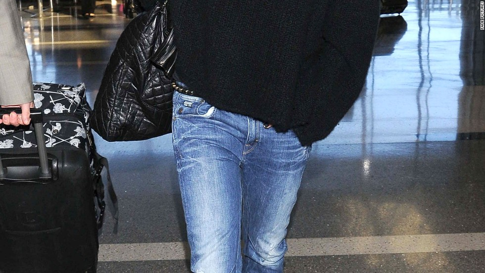 Heidi Klum packs light for a departing flight from Los Angeles on March 10.
