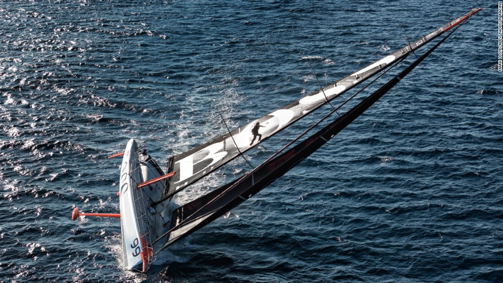 Thomson hurtles up to the top of the mast, aware that the boat can keel at any moment and fling him either onto the deck or the water below
