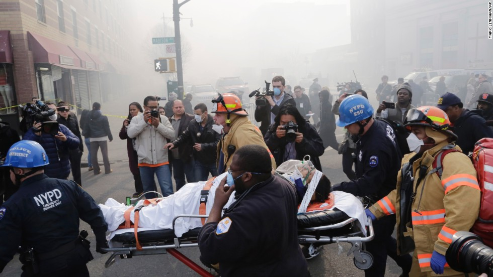 Rescue workers remove an injured person from the scene.